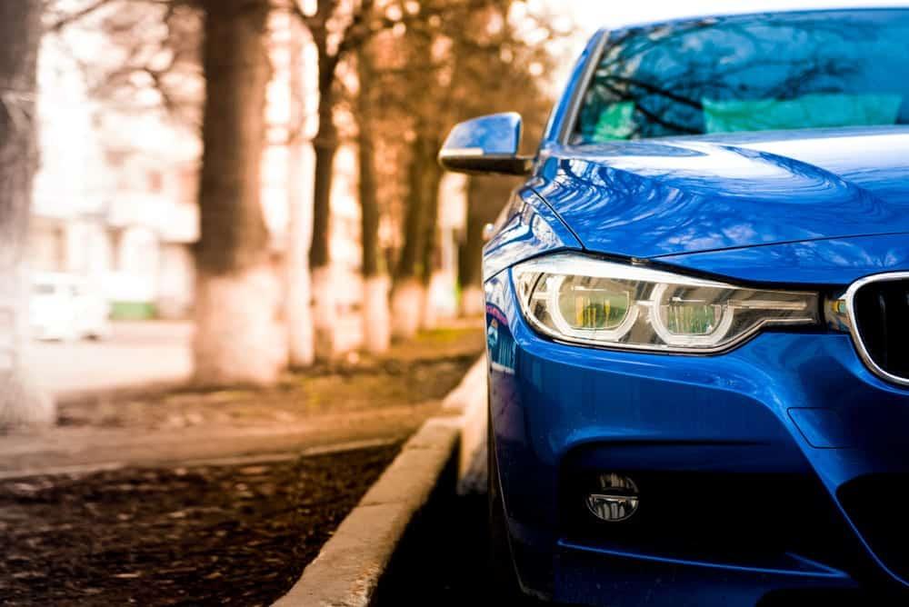 Stunning blue BMW car on road.