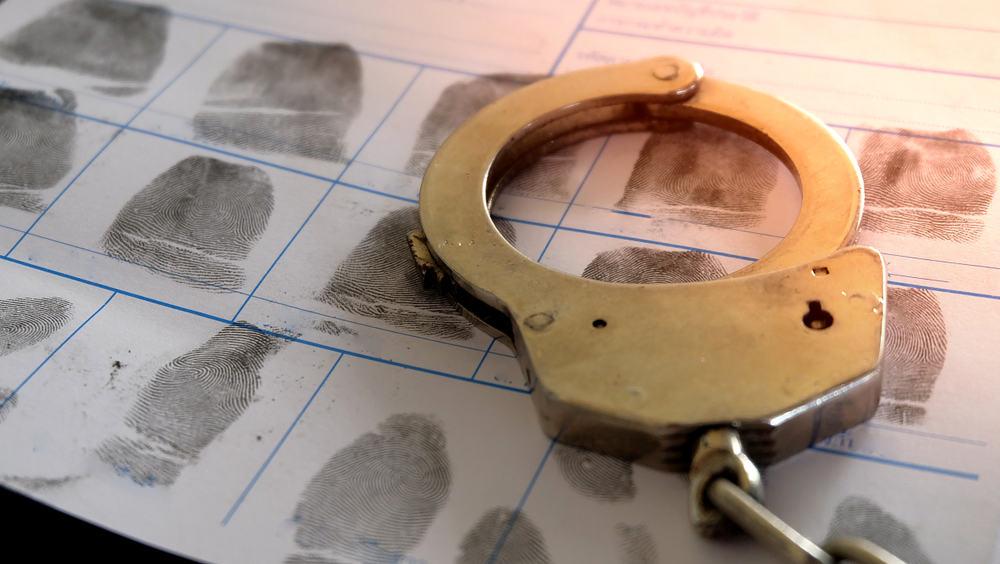 Handcuffs and Fingerprints